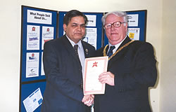 Dr.B.K.Sharma, founder of these charities receiving honour of the year award at the hands of Mayor of Walsall