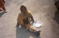 Street woman beggar with severe disability