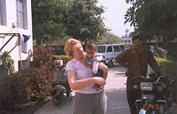 Volunteer and charity trustee Lynda McShane with a child at Gwalior hospital operated for cleft lip and palate.